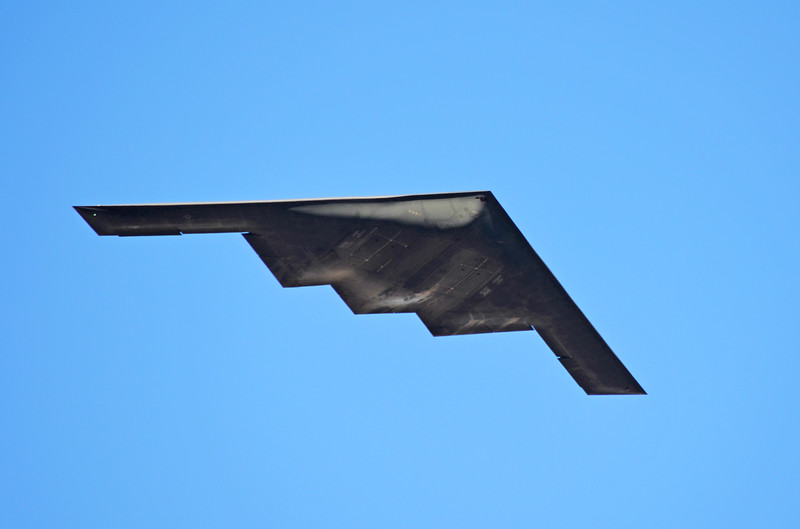 "The B2 Bomber Spirit (the ""Stealth"") during its flyover of the 2012 Rose Parade in Pasadena. The photo was taken from the top of the Pasadena City College garage on Bonnie. I lightened up the underside of the plane in Photoshop Elements to better see the markings."
