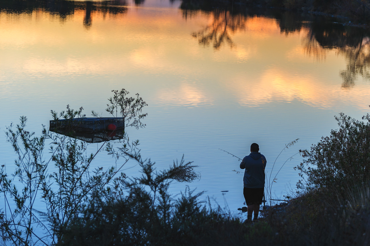 An angler at Santa Fe Dam Recreation Area in Irwindale, a popular fishing spot for Foothill residents.