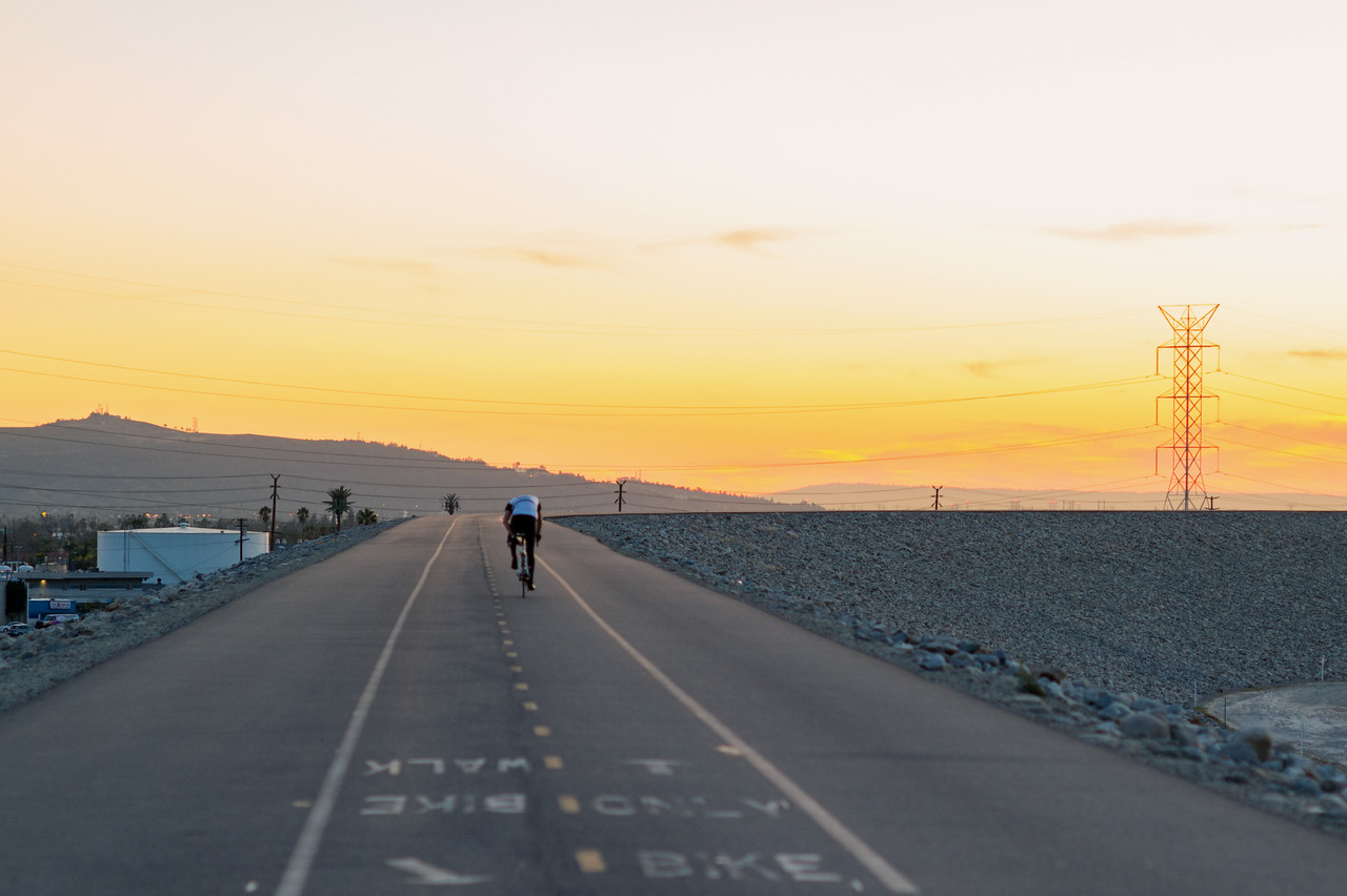 A cyclist on the bike path atop Santa Fe Dam in Irwindale.