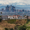 Downtown Los Angeles skyline with snowy mountains in backdrop