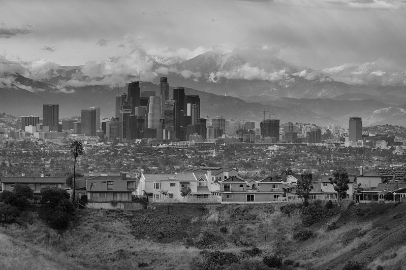 Downtown Los Angeles skyline black and white with mountains and snow