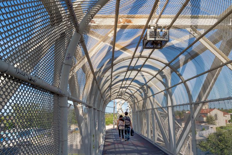 Pedestrian bridge over Blue Line tracks in Watts.