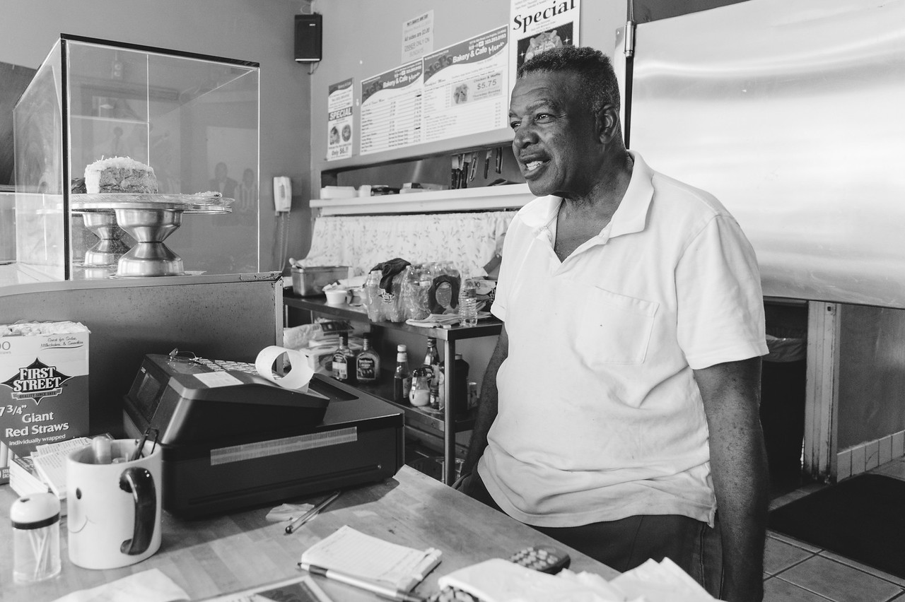 Melvin Boyland, the owner of Mel's Bakery & Cafe at 48th & Cimmaron Street in Vermont Square. A former bus driver, Mel bought the place a few years ago and has seen a lot of money come into the neighborhood -- even some USC students are buying up homes.
