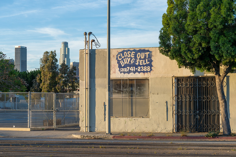 Old storefront and downtown L.A. skyline, Washington Boulevard.