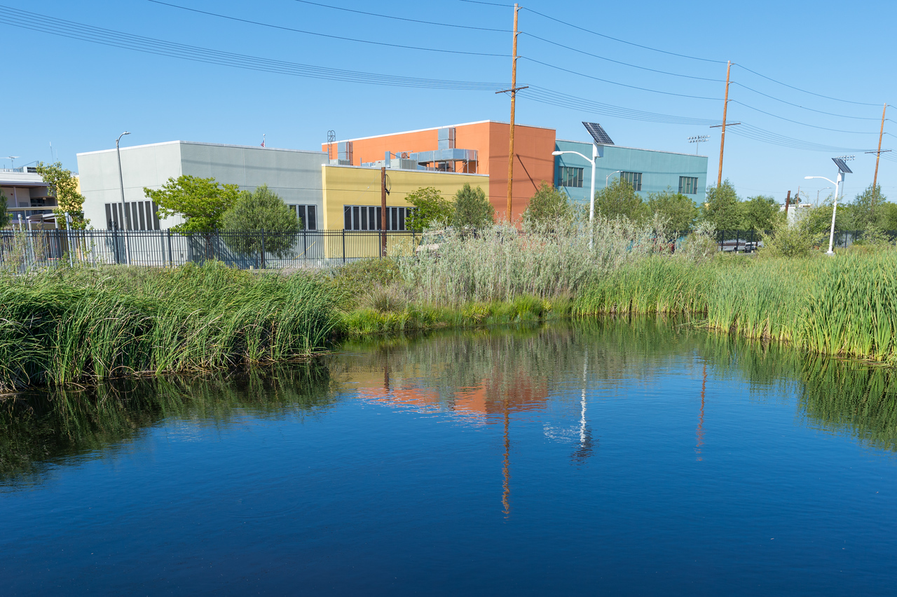 South Los Angeles Wetlands Park with the Dr. Maya Angelou Community High School in background.
