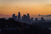 The downtown Los Angeles skyline at dusk.