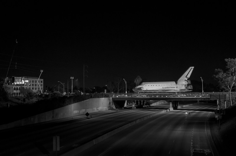 Space shuttle Endeavour crossing empty 405 freeway on Manchester Boulevard.
