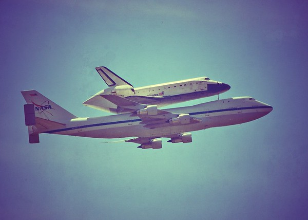 The space shuttle Endeavour flying over the Los Angeles area on Sept. 21, 2012. The photo was taken from Chaney Trail in the Angeles National Forest looking toward NASA's Jet Propulsion Laboratory (JPL).