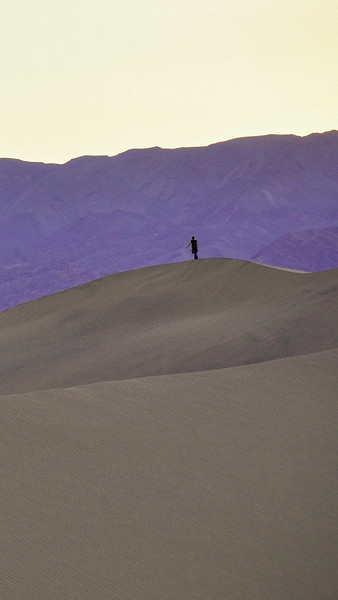 Hiker on sand dunes in Death Valley iPhone and smartphone wallpaper.