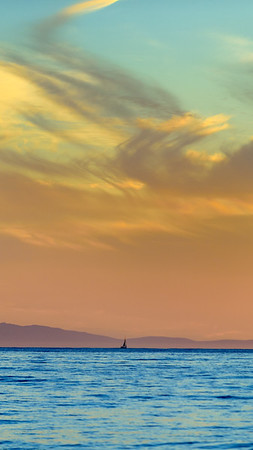 Sailboat and orange sunset iPhone and smartphone wallpaper.