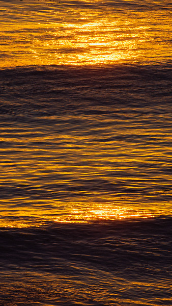 Golden ocean waves at sunset iPhone wallpaper