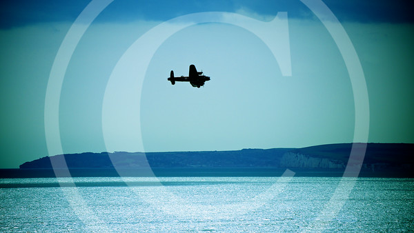 Lancaster-Bomber-Over-Sea-Returning-Home