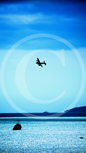Lancaster-bomber-banking-over-sea-returning-home-print