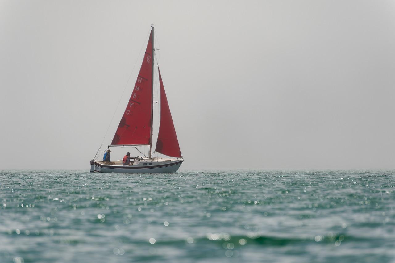 Sailboat with red sail, Half Moon Bay, CA