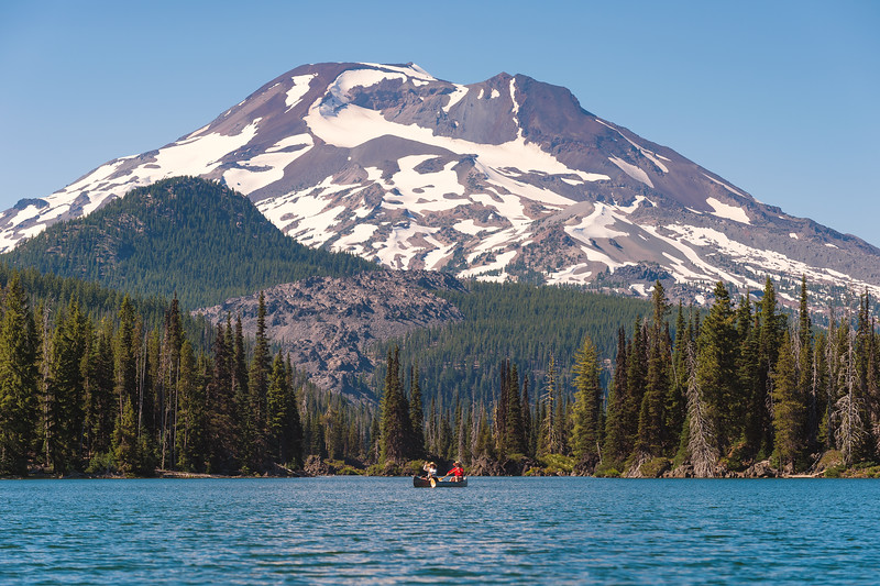 Canoeists on Sparks Lake in Deschutes National Forest with South Sister in background.