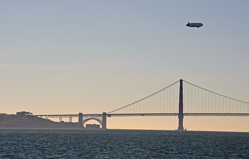 The Farmers blimp over the Golden Gate Bridge.