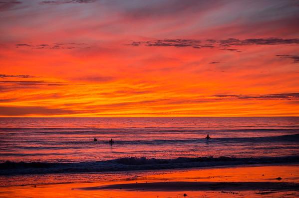Surfers amid a spectacular sunset at Arroyo Burro beach in Santa Barbara in Dec. 2013.