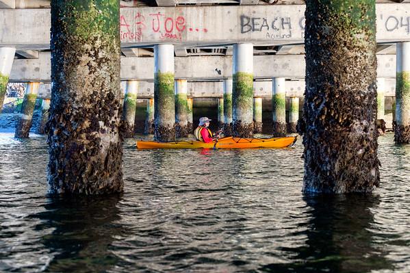 Kayaker under bridge on Alamitos Bay, Long Beach.