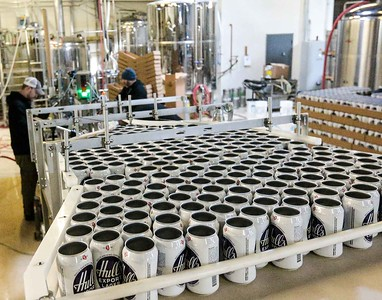 (John Vanacore/for Hearst Connecticut Media) Empty Hulls cans are ready to be filled with the original recipe of Hulls beer at East Haven's Overshores Brewing Company.
