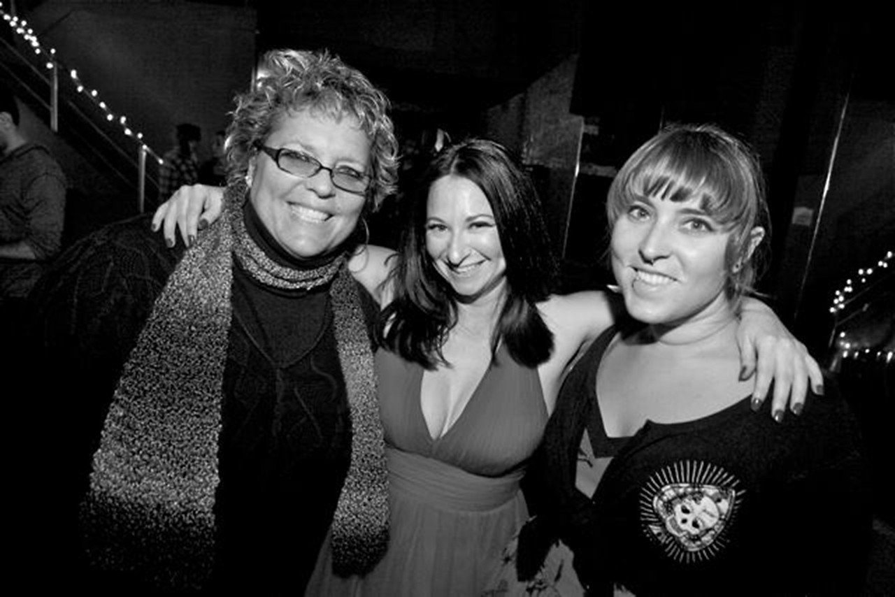 Rebecca Dru and Jami Cakes sandwich Nikki Levy at Don't Tell My Mother, Fais DoDo in Los Angeles