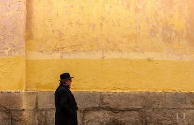 Man and Yellow Wall