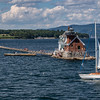 Sailing past Rockland breakwater and Light