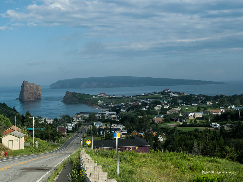 Town of Percé, Quebec.   Percé Rock on left, Bonaventure Island in background