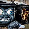 Graffiti on dumpsters Brick Lane London UK