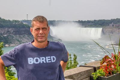Don Aaron standing in front of horseshoe falls, Niagara Falls, Ontario, Canada