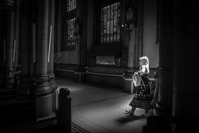 A woman walks into the light in this Greek Orthodox church in Istanbul.