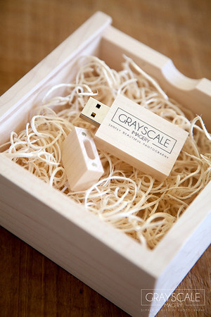 Personalized USB flash drives with cute custom designed box loaded with your wedding or engagement photographs from Grayscale Imagery. Can be custom designed with couple's names on the USB stick and their names or photo on the box.
