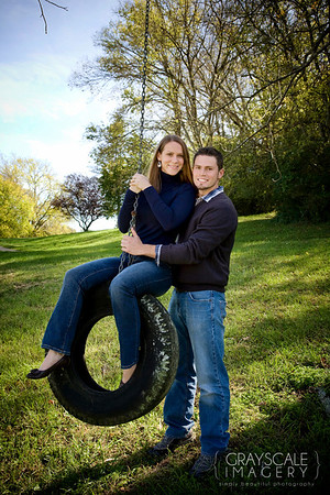 couple outdoors on tire swing