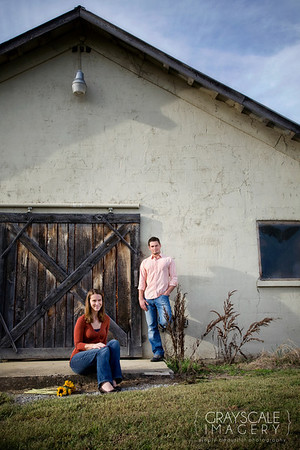 Couple in front of rustic shed