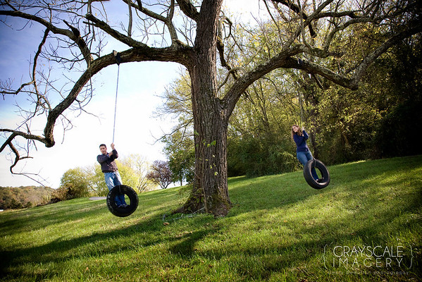 couple swinging from tire swings