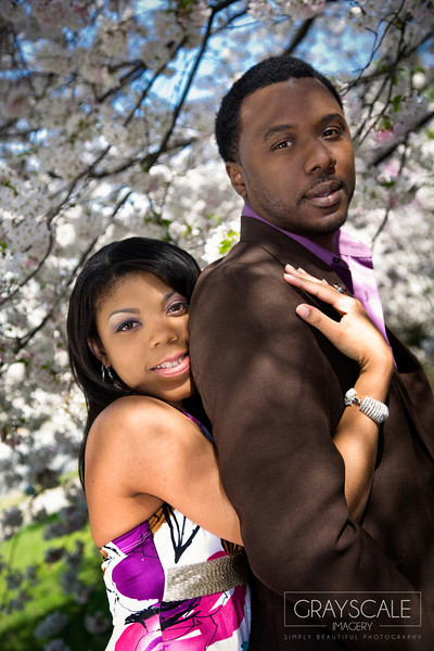 couple under beautiful blooming bradford pear trees