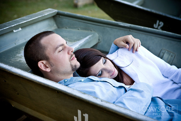 Couple cuddles in a boat