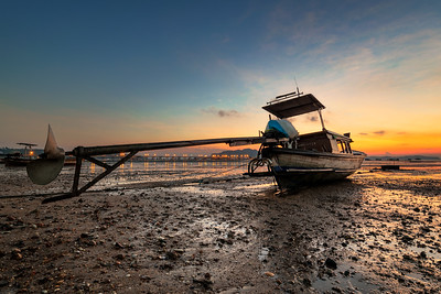 Colorful sunrise at Ao Por during low tide