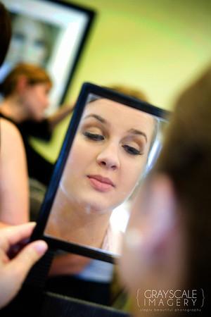 bride checks eyelashes in the mirror