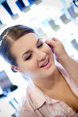 Applying makeup to bride