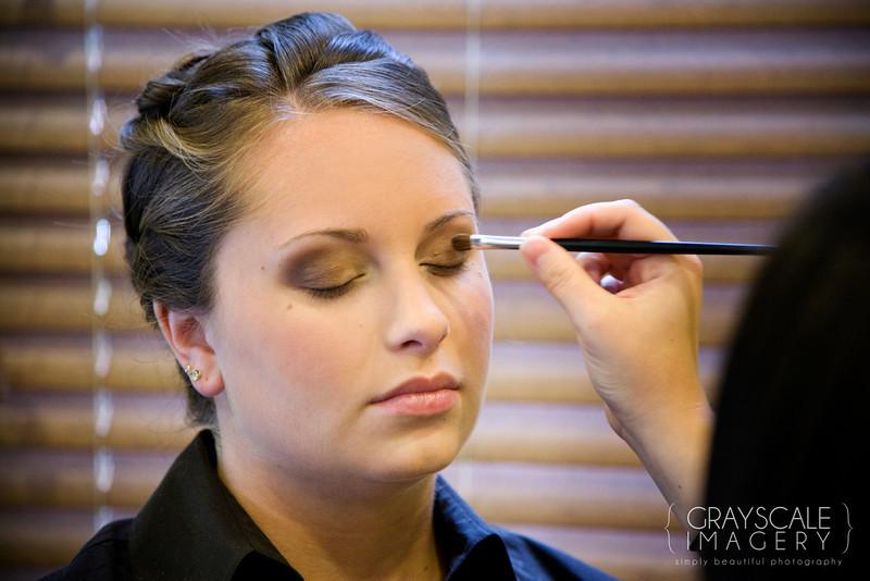 Applying makeup to bridesmaid