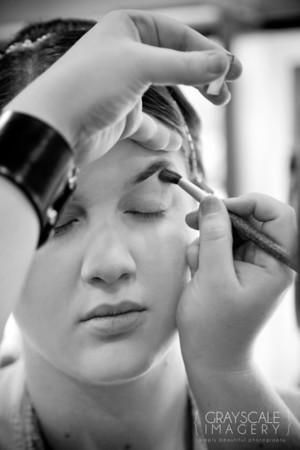 Applying makeup to bride
