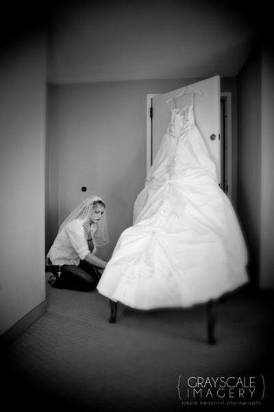 Bride preparing, primping wedding dress