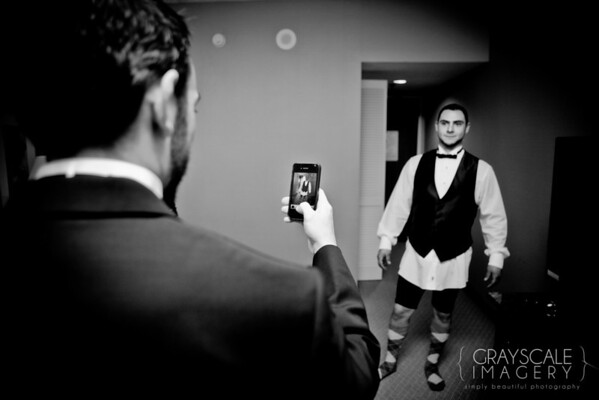 Groomsmen prepare, iPhone photo of funny socks