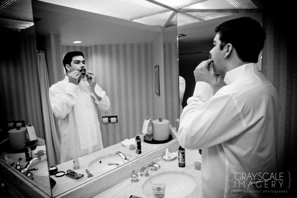 Groomsmen prepare, waxing mustache