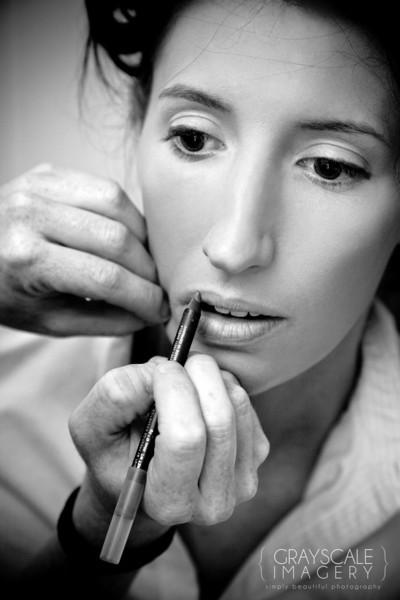 Bride having lipliner applied