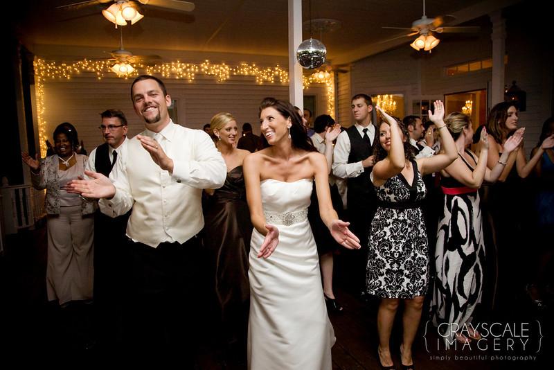 bride, groom and guests dance