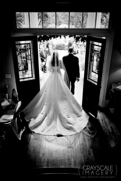 Bride and Father enter outdoor ceremony on mansion porch