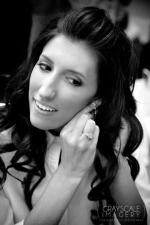 Bride puts on earrings