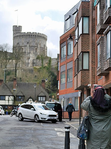 Tourist photographying Windsor Castle from tablet