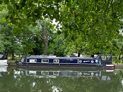 House Boat at Windsor, England, UK. It looks so beautiful through the trees